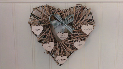 "Wicker ""family"" heart hung with hand"