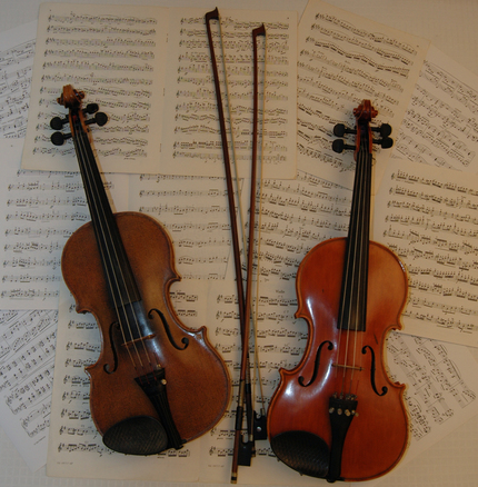 Violins with bows and music
